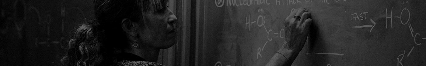 senior writing on chalkboard